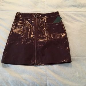 Patent leather maroon zip front skirt